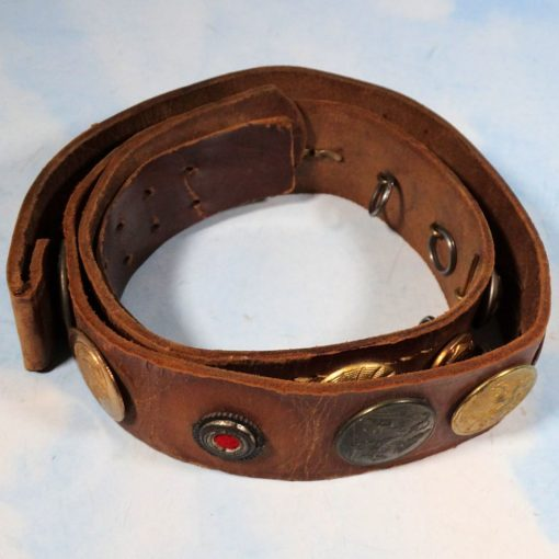 """BELT - """"HATE BELT"""" ASSEMBLED BY AMERICAN SOLDIER - FEATURES TWENTY-FOUR DIFFERENT BUTTONS, INCLUDING A KOKARDE AND OFFICER'S PIPS"""