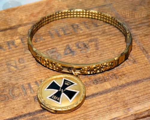 GERMANY - PATRIOTIC BRACELET - MADE FROM THE DRIVING BAND OF AN ARTILLERY SHELL - FEATURING LOCKET WITH IRON CROSS MOTIF
