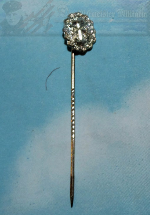 This is a silver Navy wound badge stickpin. The Navy wound badge was authorized during the Summer of 1918 whereas the army version was authorized in March 1918.