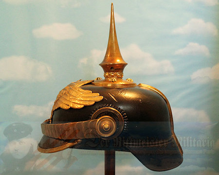 "This is a spike helmet for an officer in Grenadier  Regiment 4  in the 1911 – 1914  period. Officially it was known as Grenadier-Regiment König Friedrich der Große (3. Ostpreußches) Nr 4. This regiment was founded in 1626 and was garrisoned at Rastenberg in East Prussia, where it was attached to the Prussian I. Armeekorp. .  The helmet originally took the Heraldic Eagle with the shorter wings and FWR on its breast.  A large banner above the eagle inscribed with the number ""1626  was awarded by AKO on 6 Nov 1888, to commemorate the date that the regiment was activated.  Grenadier-Regiment  Nr 4 was the oldest regiment in the Imperial Army, and the Kaiser chose to honor the unit with the addition of its activation date on its helmet plate.  The short winged style plate was worn until 1 May 1911 when it was replaced with the wide winged Grenadier Eagle shown on this helmet."
